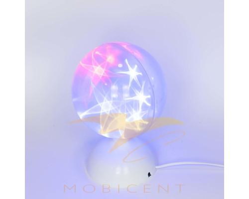 Лампа шар крутящийся на подставке создает новогодний свет